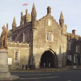 Meet at under the arch at the Guildhall in Tavistock