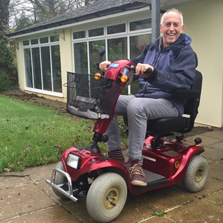 Image of John on a mobility scooter